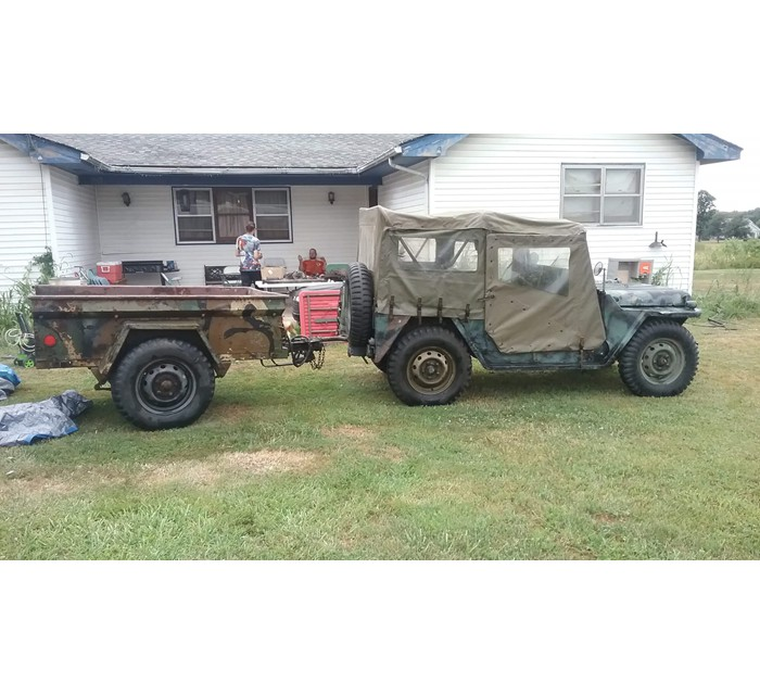 Jeep with trailer extra tires and parts